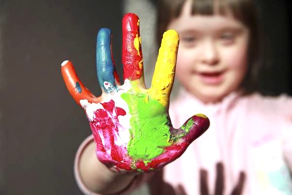 Cute girl with painted hand