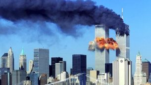 the_twin_towers_moments_after_being_hit_by_the_two_planes-696x390